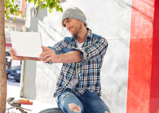 Young man selfie with tablet pc touch in bicycle Royalty Free Stock Photography