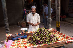 Young man selling fruits in the street of Delhi, India Stock Images