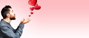 Free Young Man Sending Air Kiss And Polygonal Diamond Shaped Red Hearts Royalty Free Stock Image - 172375216