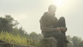 Young man. Sending email with cell phone stock video