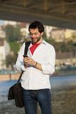 Young man sending text message on mobile phone Royalty Free Stock Images