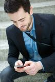 Young man sending text message Stock Photo