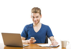 Young man sending text messages Stock Photo