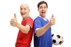 Young man and senior with football making thumb up signs Royalty Free Stock Photos