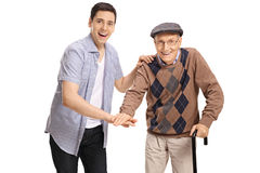 Young man and a senior putting their hands together Stock Photos