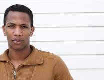 Young man with serious expression. Close up portrait of a young man with serious expression on face Stock Photos