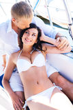 Young man and a sexy woman relaxing on a boat Royalty Free Stock Image