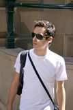 Young man with shades. A young man walking through the city with shades Stock Images