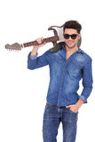 Young man with shades and guitar Royalty Free Stock Photo