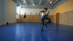 Young man shadow boxing coaches in the hall of MMA. Practice melee combat in the martial arts hall stock video