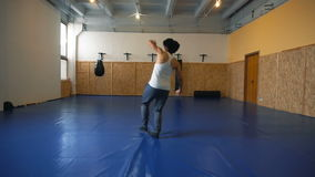 Young man shadow boxing coaches in the hall of MMA. Practice melee combat in the martial arts hall stock video footage