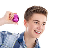 Young man shakes the egg Stock Photography