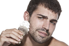 Young man shaving Stock Image