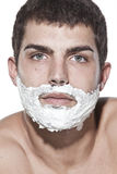Young man shaving Royalty Free Stock Photos