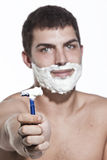 Young man shaving Royalty Free Stock Image