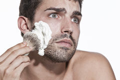 Young man shaving Royalty Free Stock Photo