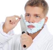 Young man shaving Stock Photos