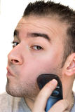 Young Man Shaving Stock Photo