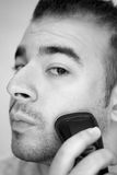 Young Man Shaving Royalty Free Stock Photography