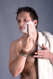 Young man shaving antique cutthroat Stock Photography