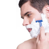 Young man shaving the  beard with the razor Royalty Free Stock Photos