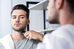 Man shaving with electric trimmer Stock Image