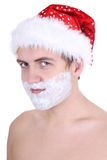 Young man with shaving foam in santa hat Royalty Free Stock Image