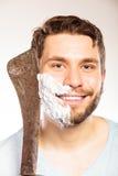 Young man shaving having fun with machete. Stock Photos