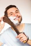 Young man shaving having fun with machete. Stock Photography
