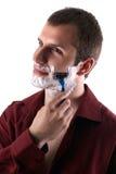 Young man shaving his beard. Happy man shaving his beard Stock Images