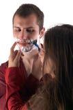 Young man shaving his beard. Happy man shaving his beard Royalty Free Stock Images