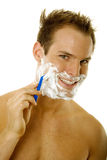 Young man shaving his beard Royalty Free Stock Image