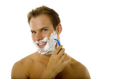 Young man shaving his beard Stock Photo
