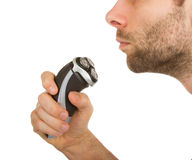 Young man shaving his beard off Stock Photography