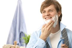 Young man shaving in the morning Royalty Free Stock Image