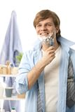 Young man shaving in the morning Royalty Free Stock Photography