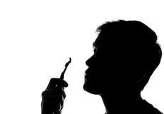 Young man shaving - silhouette Stock Photos