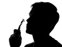 Young man shaving - silhouette Stock Photography