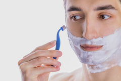 Young man shaving Stock Photos