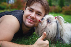 Young man and shih tzu. Dog portrait stock image