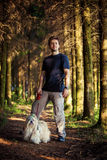 Young man and shih tzu Stock Photography