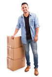 Young man shipping a few boxes Stock Photo