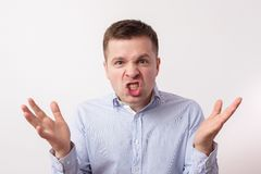 Young man in  shirt in anger shouts and threatens Royalty Free Stock Image