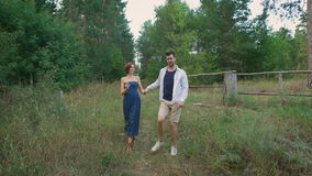 Young man in shirt and sh rtah leads for a his beloved wife. stock footage