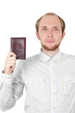Young man in shirt showing his passport isolated Royalty Free Stock Images