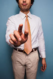 Young man in shirt and tie pushing button Royalty Free Stock Image