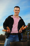 Young man with a shish kebab Stock Photos