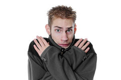 Young man shivering Royalty Free Stock Image