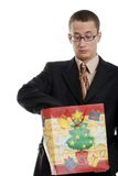 Young man shocked with christmas present Royalty Free Stock Photography