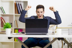 Happy man on laptop Stock Image